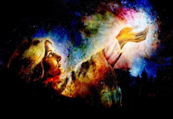 Beautiful woman hands holding light