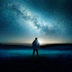 An Alone Man Is Standing And Looking Toward Night View Of The Sky