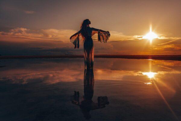 Girl on sunset beach