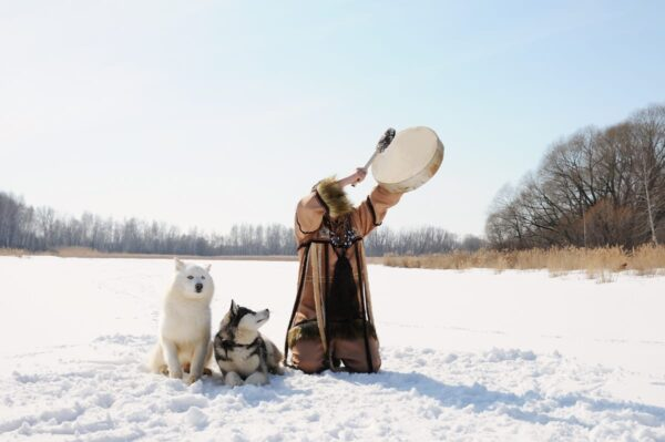 Man with wolf playin drum